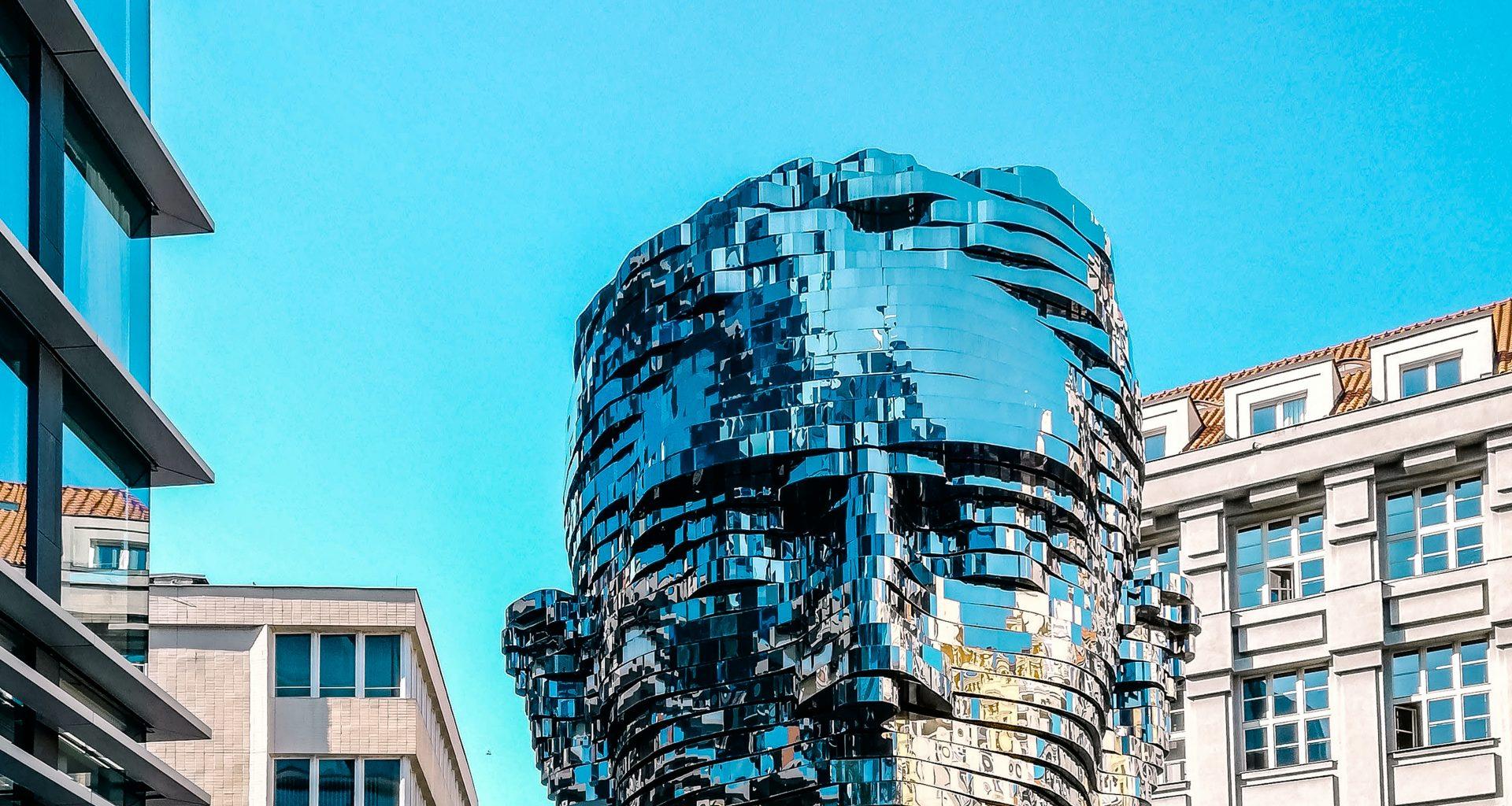 man head bust between buildings