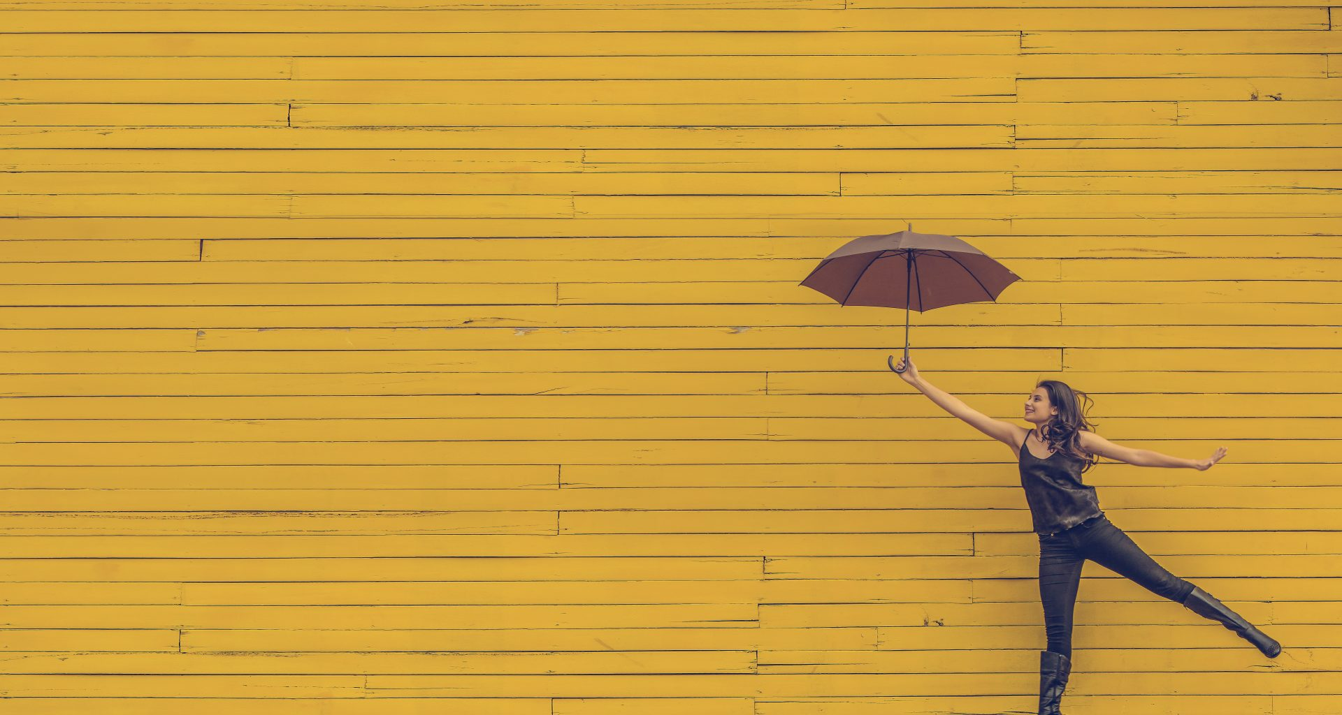 woman holding brown umbrella